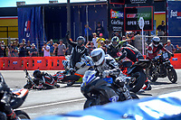 Bruce Telford crashes at the first turn in Formula 3 race two. The 2019 Suzuki International Series Cemetery Circuit motorcycle raceday at Cooks Gardens in Wanganui, New Zealand on Thursday, 26 December 2019. Photo: Dave Lintott / lintottphoto.co.nz