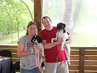 Libby Leifer and Ben Smith, with Champ (left) and Charlie attend Dog Days of Summer.<br /> (NWA Democrat-Gazette/Carin Schoppmeyer)