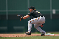 Pittsburgh Pirates first baseman Mason Martin (10) waits for a throw during a Minor League Spring Training game against the Baltimore Orioles on April 21, 2021 at Pirate City in Bradenton, Florida.  (Mike Janes/Four Seam Images)