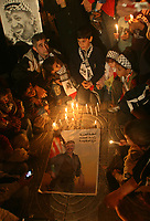 """Palestinian children hold candles and posters of the late Palestinian leader Yasser Arafat during a ceremony marking the third anniversary of his death in Gaza City, Sunday, Nov. 11, 2007. Arafat died in a Paris hospital on Nov. 11, 2004. """"Fady Adwan"""""""
