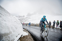 Gorka Izagirre (ESP/Astana - Premier Tech) coming over the Passo Giau<br /> <br /> due to the bad weather conditions the stage was shortened (on the raceday) to 153km and the Passo Giau became this years Cima Coppi (highest point of the Giro).<br /> <br /> 104th Giro d'Italia 2021 (2.UWT)<br /> Stage 16 from Sacile to Cortina d'Ampezzo (shortened from 212km to 153km)<br /> <br /> ©kramon