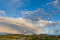 Trans Alaska oil pipeline traverses the tundra landscape in the Alaska mountain range.