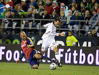 Real Salt Lake's Robbie Russell knocks Landon Donovan of the LA Galaxy off the ball. Real Salt Lake defeats the Los Angles Galaxy 5-4 on penalty kicks to win the 2009 MLS Cup at Qwest Field, Sunday, Nov. 22, 2009.