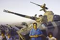 Irak 1991 Une femme et ses enfants posant devant une auto-mitrailleuse de l'armée irakienne capturée par son mari.Iraq 1991.A woman and her children in front an armored vehicule of the Iraqi army  taken by her husband