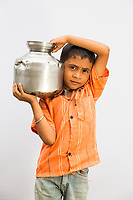 Aditya Vardule, 6, helps his family collect pots of water everyday from government tankers which deliver water to the village of Sayyad Ankulga near the drought-hit city of Latur.