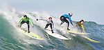 Antony Tashneck (green), Evan Slayter (white), Russell Smith (blue) and Grant Twiggy Baker share the same wave.