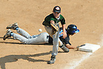 Aberdeen, MD: Willamette Valley's Dustyn Smith moves to catch a throw to first as Tampa's Brandt Burrows slides safely into first at Thursday afternoon's game at the 2009 Cal Ripken World Series