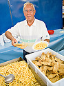 """SAGRA DEL """"PESCE E PATATE"""" 2011, BARGA, ITALY<br /> <br /> ONE OF THE PIONEERS OF THE FESTIVAL, MARCO MARCHETTI (80), RETURNS TO HELP SERVE UP THE FISH AND CHIPS."""