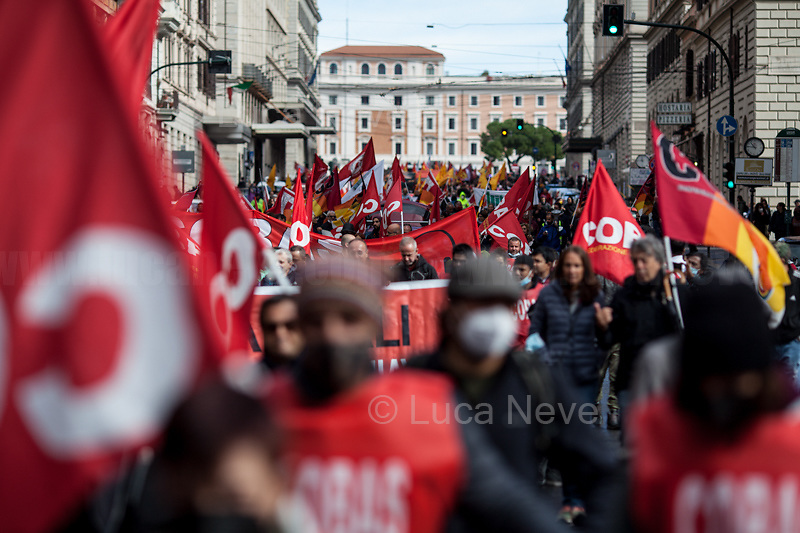Rome, Italy. 11th October, 2021. Today, the Trade Unions: Cobas, Cub, Usb Lavoro Privato, Orsa, Sgb - supported by the Alitalia workers, state school and University precarious workers, GKN workers, students, and some extra-parliamentary lefty Parties - held a 24-hour General Strike to protest against the economic policies of the Italian Government led by Mario Draghi. The demonstration started in Piazza della Repubblica and ended in Via Dei Fori Imperiali.