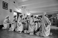 """Calcutta, India. April 04, 1975.<br /> Mother Teresa prays in the morning hours along with the other sisters as part of the """"Missionaries of Charity"""" Mother Teresa (Agnes Gonxha Boyaxihu) the Roman Catholic, Albanian nun revered as India's """"Saint of the Slums,"""" was awarded the 1979 Nobel Peace Prize."""