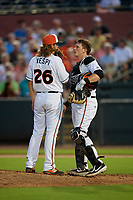 Delmarva Shorebirds relief pitcher Nick Vespi (26) talks with catcher Adley Rutschman (37) during a South Atlantic League game against the Greensboro Grasshoppers on August 21, 2019 at Arthur W. Perdue Stadium in Salisbury, Maryland.  Delmarva defeated Greensboro 1-0.  (Mike Janes/Four Seam Images)