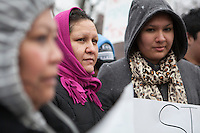 Esperanza Pacheco (red scarf) and her daughter Esmeralda Moctezuma (grey hood). At a protest in  Erie, PA on March 20, 2014.  The protest was held in support of Alfredo Ramos an immigrant whose two children are American Citizens. Ramos was facing  immigration related charges at the Federal Court building in Erie, PA.  Pacheco is  American citizen who, like many Mexican parents of American citizen children, in the Painesville, Ohio community face the possibility of deportation.  Photo: Brendan Bannon. Erie, PA March 20, 2014.