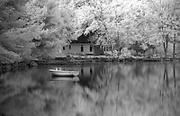 Tranquil scene of lake and small boat, Long Lake, Bridgton, Maine, New England. Infrared
