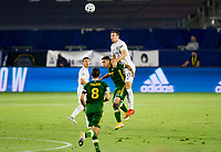 CARSON, CA - OCTOBER 07: Sacha Kljestan #16 of the Los Angeles Galaxy leaps over Felipe Mora #9 of the Portland Timbers for a ball during a game between Portland Timbers and Los Angeles Galaxy at Dignity Heath Sports Park on October 07, 2020 in Carson, California.
