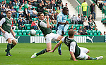 Hibs v St Johnstone...25.08.12   SPL.Nigel Hasselabink shoots wide of goal as he is closed down by Paul Hanlon and James McPake.Picture by Graeme Hart..Copyright Perthshire Picture Agency.Tel: 01738 623350  Mobile: 07990 594431