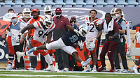 CHAPEL HILL, NC - OCTOBER 10: Michael Carter #8 of North Carolina is knocked out of bounds by Norell Pollard #96 of Virginia Tech at the end of an 18-yard run during a game between Virginia Tech and North Carolina at Kenan Memorial Stadium on October 10, 2020 in Chapel Hill, North Carolina.