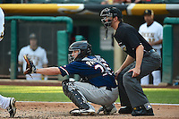 Jordan Pacheco (26) of the Reno Aces behind the plate with home plate umpire Travis Eggert during the game against the Salt Lake Bees in Pacific Coast League action at Smith's Ballpark on July 24, 2014 in Salt Lake City, Utah.  (Stephen Smith/Four Seam Images)