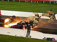 Sep 2, 2016; Clermont, IN, USA; NHRA funny car driver Robert Hight (left) slides sideways on fire after an engine explosion alongside Dave Richards during qualifying for the US Nationals at Lucas Oil Raceway. Hight was uninjured in the explosion. Mandatory Credit: Mark J. Rebilas-USA TODAY Sports