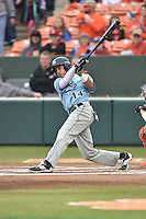 Main Black Bears shortstop Jeremy Pena (14) swings at a pitch during a game against the Clemson Tigers at Doug Kingsmore Stadium on February 20, 2016 in Clemson, South Carolina. The Tigers defeated the Black Bears 9-4. (Tony Farlow/Four Seam Images)