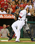 Los Angeles Angels Erick Aybar collides with Seattle Mariner catcher Henry Blanco at home plate.