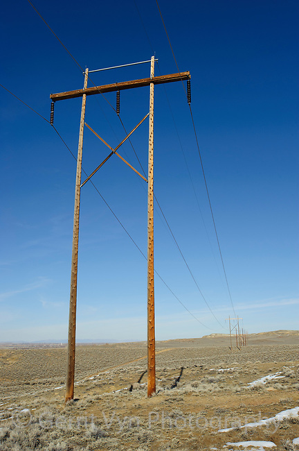 Powerlines across sage lands. Some speceis of grouse avoid tall strctures that provide perches for raptors like Golden Eagles. Freemont County, Wyoming. March.