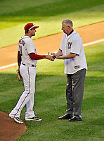 11 October 2012: Former Washington Senator Frank Howard greets third baseman Ryan Zimmerman after throwing out the ceremonial first pitch prior to Postseason Playoff Game 4 of the National League Divisional Series against the St. Louis Cardinals at Nationals Park in Washington, DC. The Nationals defeated the Cardinals 2-1 on a 9th inning, walk-off solo home run by Jayson Werth, tying the Series at 2 games apiece. Mandatory Credit: Ed Wolfstein Photo