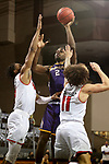 SIOUX FALLS, SD - MARCH 6: Tamell Pearson #2 of the Western Illinois Leathernecks shoots against Stanley Umude #0 and Mason Archambault #11 of the South Dakota Coyotes during the Summit League Basketball Tournament at the Sanford Pentagon in Sioux Falls, SD. (Photo by Dave Eggen/Inertia)