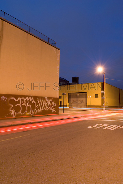 Street Scene with Car Light Trails, Industral Buildings, Graffiti and Overcast Sky in the Williamsburg neighborhood of Brooklyn, New York City, New York State, USA