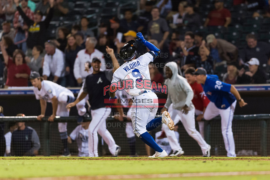 AFL West catcher Meibrys Viloria (9), of the Surprise Saguaros and Kansas City Royals organization, flips his helmet off after hitting a walk-off line drive to center field to win the Fall Stars game at Surprise Stadium on November 3, 2018 in Surprise, Arizona. The AFL West defeated the AFL East 7-6 . (Zachary Lucy/Four Seam Images)