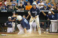 North Carolina third baseman Colin Moran (18) celebrates as teammate Cody Stubbs (25) scores during Game 10 of the 2013 Men's College World Series against the North Carolina State Wolfpack on June 20, 2013 at TD Ameritrade Park in Omaha, Nebraska. The Tar Heels defeated the Wolfpack 7-0, eliminating North Carolina State from the tournament. (Andrew Woolley/Four Seam Images)