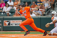 Oklahoma State Cowboys outfielder Ryan Sluder #56 follows through on his swing during the NCAA baseball game against the Texas Longhorns on April 26, 2014 at UFCU Disch–Falk Field in Austin, Texas. The Cowboys defeated the Longhorns 2-1. (Andrew Woolley/Four Seam Images)