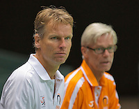 Switserland, Genève, September 16, 2015, Tennis,   Davis Cup, Switserland-Netherlands, Practise Dutch team, Captain Jan Siemerink with in the background coach Martin Bohm<br /> Photo: Tennisimages/Henk Koster