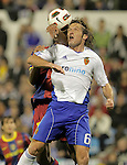 Real Zaragoza's Maurizio Lanzaro (r) and Seydou Keita during La Liga match.October 23,2010. (ALTERPHOTOS/Acero)