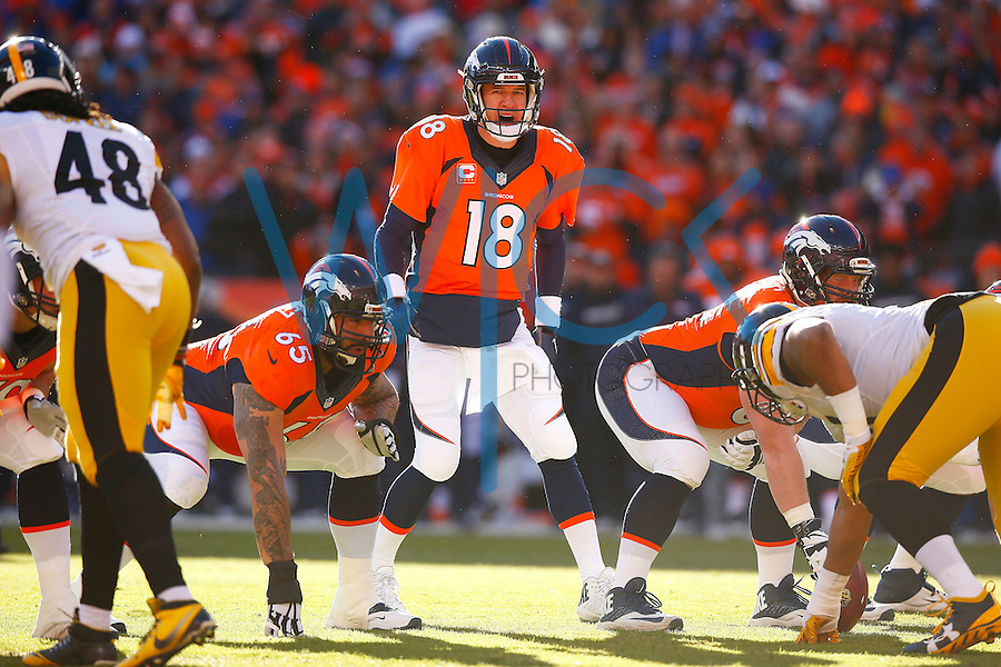 Peyton Manning #18 of the Denver Broncos stands under center against the Pittsburgh Steelers in the first half during the AFC Divisional Round Playoff game at Sports Authority Field at Mile High on January 17, 2016 in Denver, Colorado. (Photo by Jared Wickerham/DKPittsburghSports)