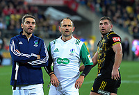 From left, assistant referee Jerome Garces, referee Romain Poite and Hurricanes flanker Callum Gibbins watch a TMO before Iain Henderson is sin binned during the 2017 DHL Lions Series rugby match between the Hurricanes and British & Irish Lions at Westpac Stadium in Wellington, New Zealand on Tuesday, 27 June 2017. Photo: Dave Lintott / lintottphoto.co.nz