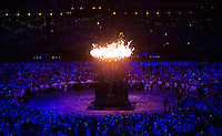 """27 JUL 2012 - LONDON, GBR - The Olympic Flame glows in the centre of the Olympic Stadium during the """"There Is a Light That Never Goes Out"""" section of the Opening Ceremony of the London 2012 Olympic Games in the Olympic Park, Stratford, London, Great Britain (PHOTO (C) 2012 NIGEL FARROW)"""