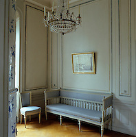 In the corner of Baroness Ottiliana Liljencrantz's dressing room stands a simple blue and white Gustavian sofa and matching chair