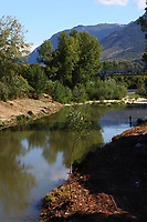A photo of the Liri river, just at the basis of the hill where is located Pontecorvo. The view is taken by looking at South. There is a fisherman in the shadow of a high tree, with beautiful reflected images of other trees in the water, and mountains on the background.<br /> <br /> You can download this file for (E&PU) only, but you can find in the collection the same one available instead for (Adv).
