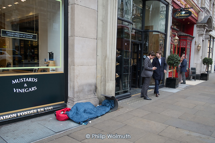 Sleeping place of a rough sleeper outside luxury shops, Piccadilly, London.