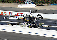 Feb. 17, 2013; Pomona, CA, USA; NHRA top fuel dragster driver Brandon Bernstein (far lane) take the first round win over Brittany Force during the Winternationals at Auto Club Raceway at Pomona. Mandatory Credit: Mark J. Rebilas-
