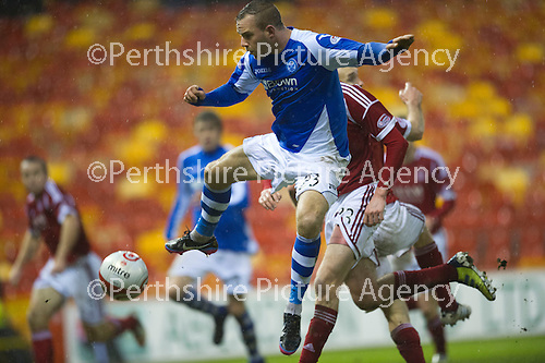 Aberdeen v St Johnstone..22.12.12      SPL.Rowan Vine gets the ball ahead of Joe Shaughnessy.Picture by Graeme Hart..Copyright Perthshire Picture Agency.Tel: 01738 623350  Mobile: 07990 594431