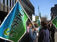 May 5 2005, Montreal (Qc) CANADA<br /> <br /> Les fonctionnaires et travailleurs membres du Syndicat de la Fonction Publique du Québec (SFPQ) manifestent devant le Palais de Justice de Montréal, lors d'une journée de débrayage, le 5 Mai 2005.<br /> <br /> Public servants and workers working for the Quebec Government protest in Montreal during a one day walk-out, may 5th 2005<br /> <br /> Photo : (c) 2005 by Pierre Roussel / Images Distribution