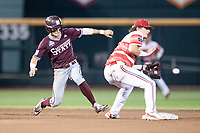 Mississippi State Bulldogs outfielder Jake Mangum (15) lunges back to second base ahead of Tyler Fitzgerald's tag during Game 10 of the NCAA College World Series against the Louisville Cardinals on June 20, 2019 at TD Ameritrade Park in Omaha, Nebraska. Louisville defeated Mississippi State 4-3. (Andrew Woolley/Four Seam Images)