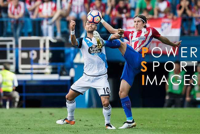 Filipe Luis of Atletico Madrid battles for the ball with Juan Domínguez of Deportivo de la Coruna during their La Liga match between Atletico Madrid and Deportivo de la Coruna at the Vicente Calderon Stadium on 25 September 2016 in Madrid, Spain. Photo by Diego Gonzalez Souto / Power Sport Images