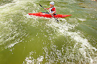 Young outdoor enthusiasts learn the art of whitewater kayaking during a summer camp session at the US National Whitewater Center (USNWC) in Charlotte NC. The USNWC is home to one of the world's largest manmade recirculating whitewater courses. Boy in photo is model released.