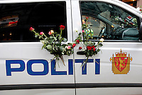 (Oslo July 25, 2011) A police car with flowers.  An estimated 150,000 people gathered in Oslo town centre for a vigil following Friday's twin extremist attacks ...A large vehicle bomb was detonated near the offices of Norwegian Prime Minister Jens Stoltenberg on 22 July 2011. .Another terrorist attack took place shortly afterwards, where a man killed 68 people, mainly children and youths attending a political camp at Utøya island. ..Anders Behring Breivik was arrested on the island and has admitted to carrying out both attacks..(photo:Fredrik Naumann/Felix Features)
