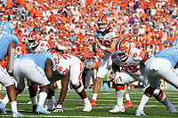 CHAPEL HILL, NC - SEPTEMBER 28: Trevor Lawrence #16 of Clemson University takes the snap during a game between Clemson University and University of North Carolina at Kenan Memorial Stadium on September 28, 2019 in Chapel Hill, North Carolina.