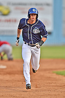 Asheville Tourists center fielder David Dahl #21 runs to third during a game against the Kannapolis Intimidators at McCormick Field on June 7, 2014 in Asheville, North Carolina. The Tourists defeated the Intimidators 7-5. (Tony Farlow/Four Seam Images)