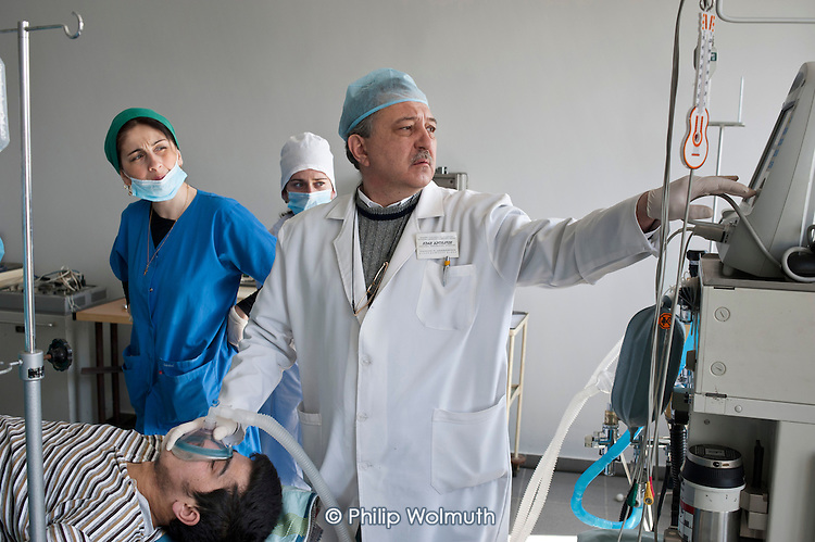 Surgeons, operating theatre nurses and an anaesthetist carry out a complex skin graft and lower leg operation in the Centre for Re-creational Plastic Surgery and Thermal Affects, Tbilisi. The formerly public premier burns and plastic surgery hospital in the Caucasus region is now owned by PSP, a private health and pharmaceutical company.  Many of Georgia's hospitals are facing the threat of privatisation.