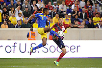 Frickson Erazo (3) of Ecuador and Clint Dempsey (10) of the United States. The men's national team of the United States (USA) was defeated by Ecuador (ECU) 1-0 during an international friendly at Red Bull Arena in Harrison, NJ, on October 11, 2011.